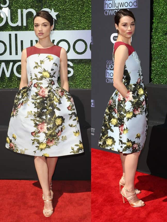 Crystal Reed wore a floral Carolina Herrera dress and Manolo Blahnik strappy gold sandals