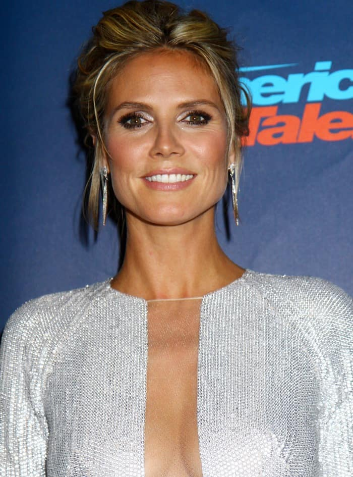Heidi Klum was a sparkling beauty in a KaufmanFranco spring 2013 metallic dress that had a plunging mesh panel