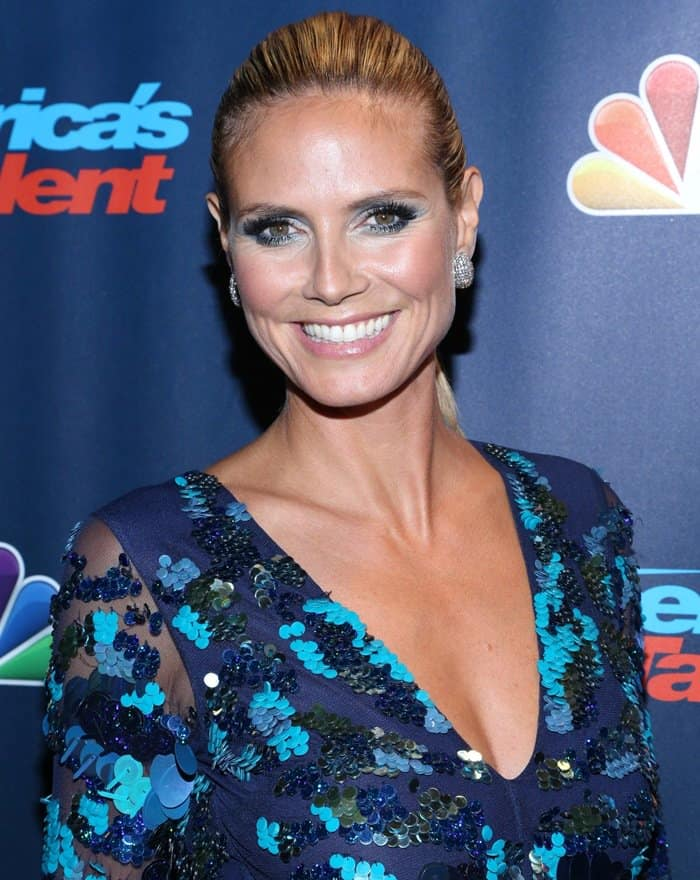 Heidi Klum pushed her blonde hair back into a sleek ponytail
