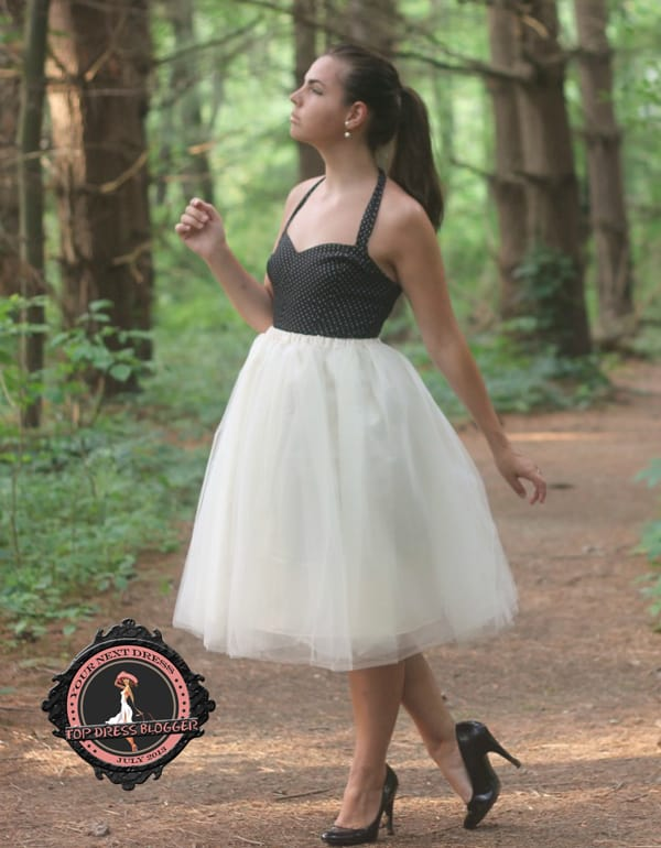 Lauren in a whimsical A-line tulle dress with black pumps