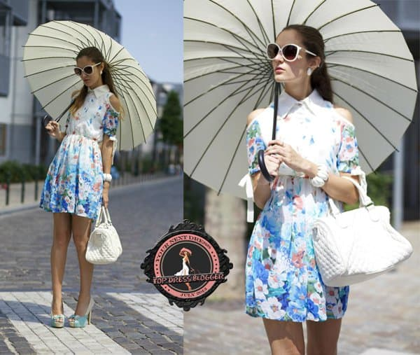 Ruxandra is eye-catching in a colorful floral dress