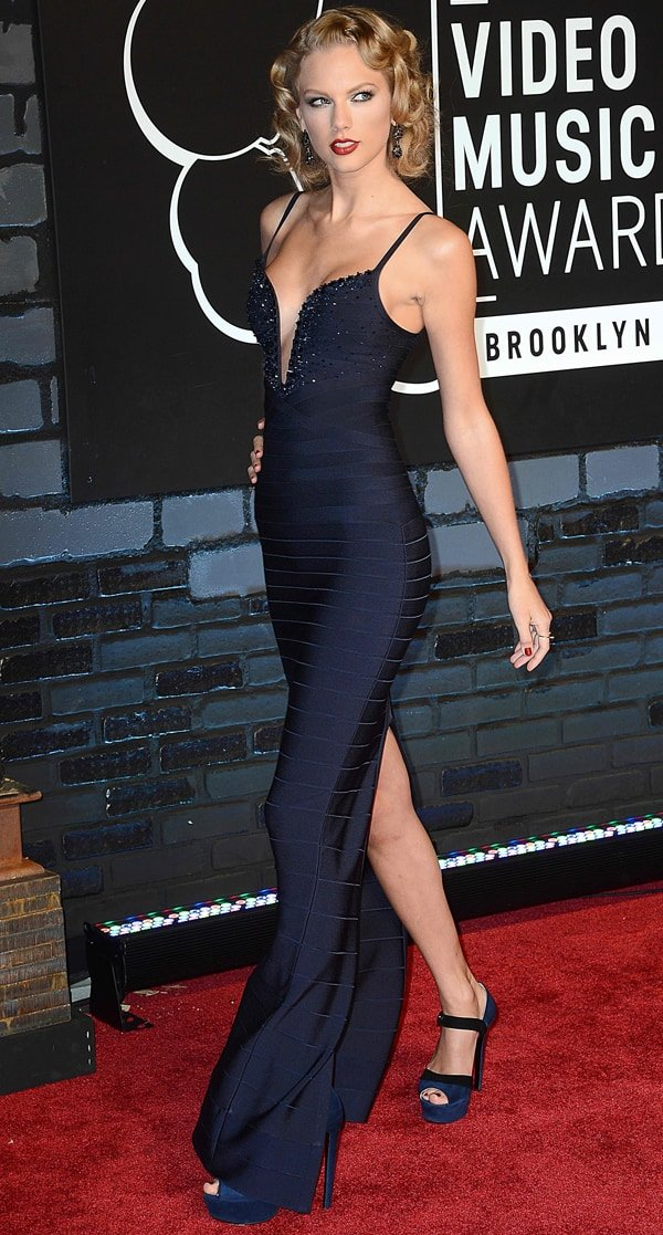Taylor Swift styled her Hervé Léger by Max Azria dress with Prada shoes