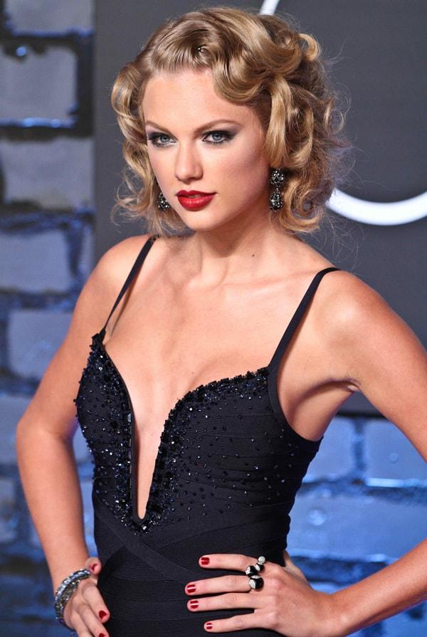 Taylor Swift accessorized with Lorraine Schwartz and Ofira jewelry