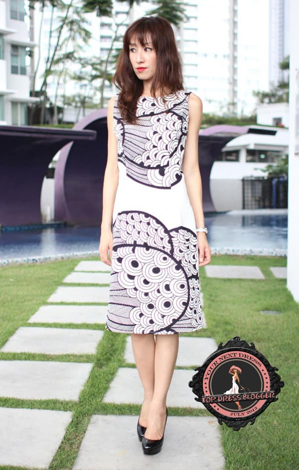 Yen in a modern-looking black-and-white printed dress