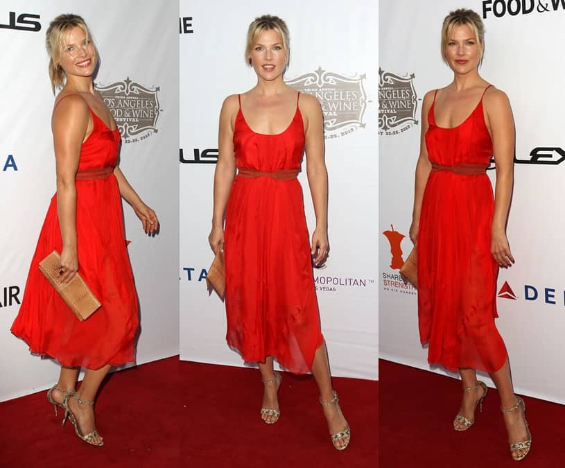 Ali Larter wearing a mid-length red chiffon dress cinched with a leather belt and printed ankle-strap heels