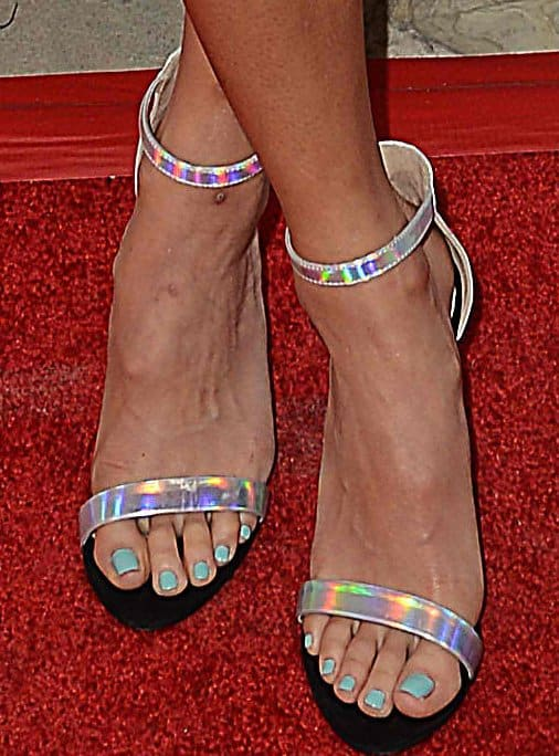Jamie Chung showing off her feet in metallic sandals