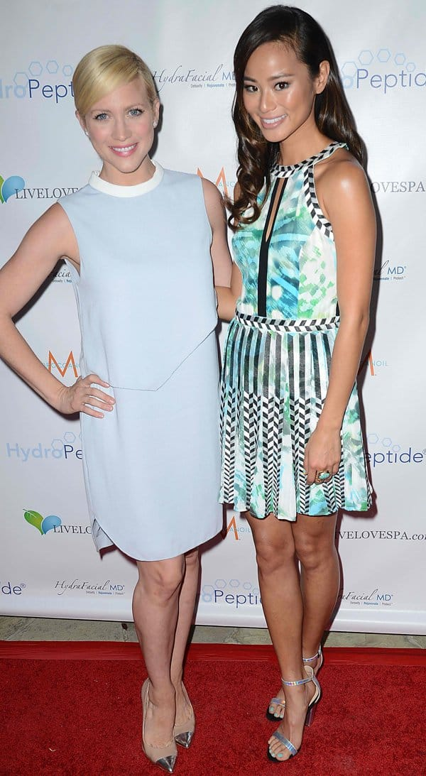 Jamie Chung, posing with Brittany Snow, at the Live Love Spa SPLASH event in Los Angeles on September 19, 2013