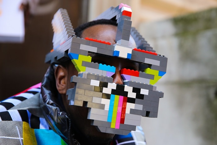Man wearing face mask made out of Lego