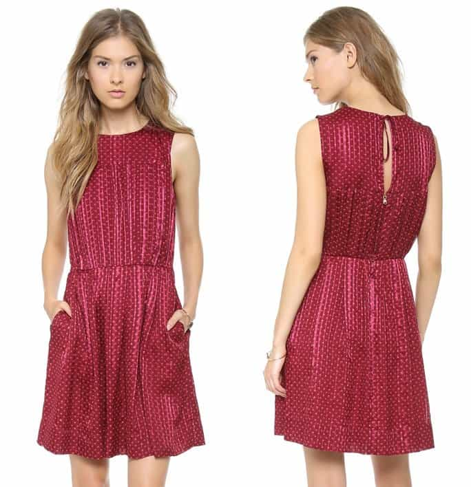 Inverted box pleats add volume to the blouson bodice of a sleeveless merlot red dress, patterned with lustrous stripes and delicate polka dots