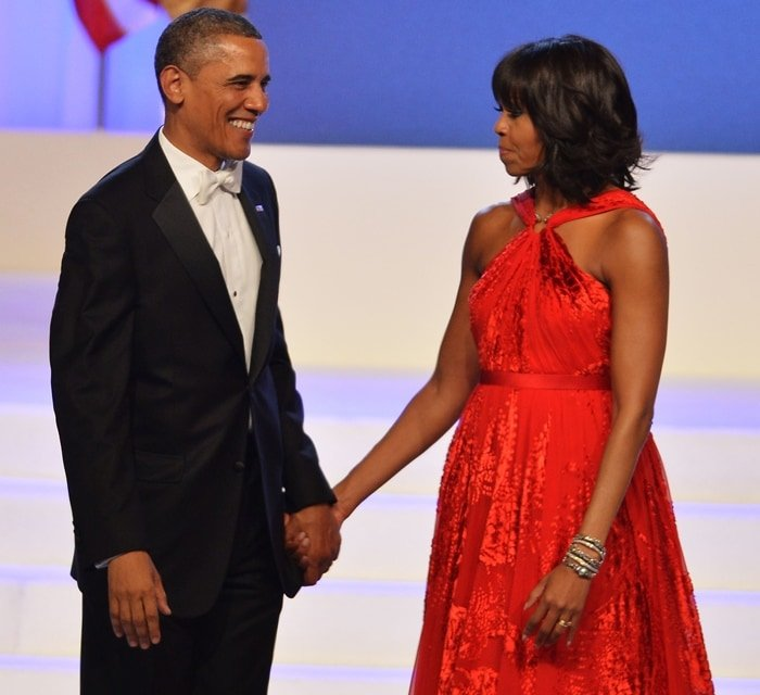 First Lady Michelle Obama wore a striking red halter dress by Jason Wu and accessorized with Kimberly McDonald jewelry at her second inaugural ball in 2013