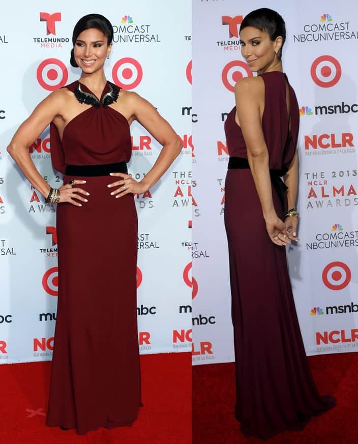 Roselyn Sanchez wearing an embroidered plum gown by Gucci