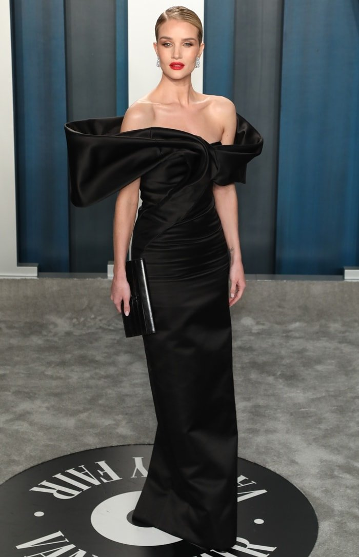 Rosie Huntington-Whiteley styled her off-the-shoulder satin Saint Laurent gown with a slick side-parted bun and Lorraine Schwartz diamond earrings