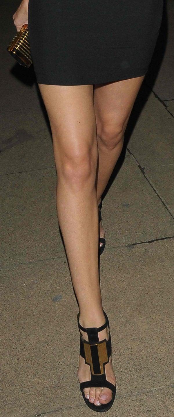 Rosie Huntington-Whiteley flaunts her endless legs in Saint Laurent sandals