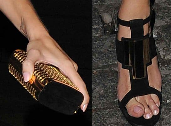 Rosie Huntington-Whiteley shows off her gold clutch and toes