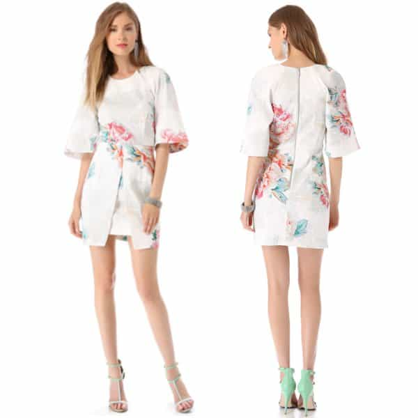 A fitted, floral twill dress is styled with a split panel over the skirt and wide, elbow-length sleeves