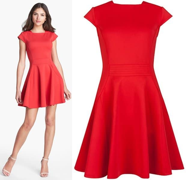 A high square neckline, topstitched waist panels and full, swingy fit captivate the eye and focus attention on a lustrous red scuba-knit dress