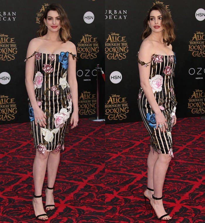 Anne Hathaway wearing a striped dress at the premiere of ' Alice Through the Looking Glass'.
