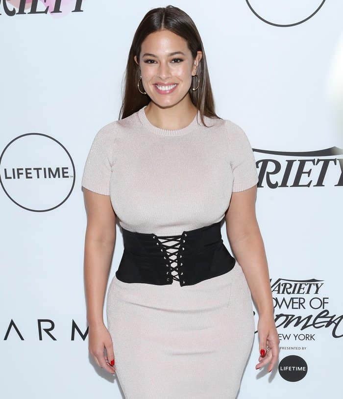 Ashley Graham shows off her small waist in a wide belt that looked like a modern corset.
