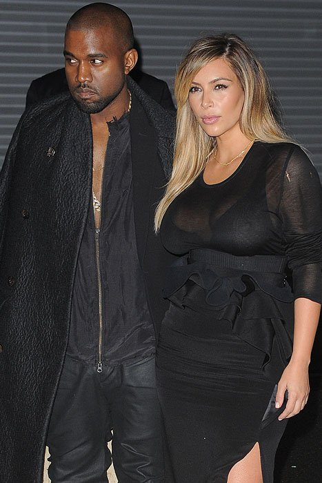 Kanye West and Kim Kardashian at the Givenchy spring 2014 RTW fashion show held during Paris Fashion Week in France on September 29, 2013