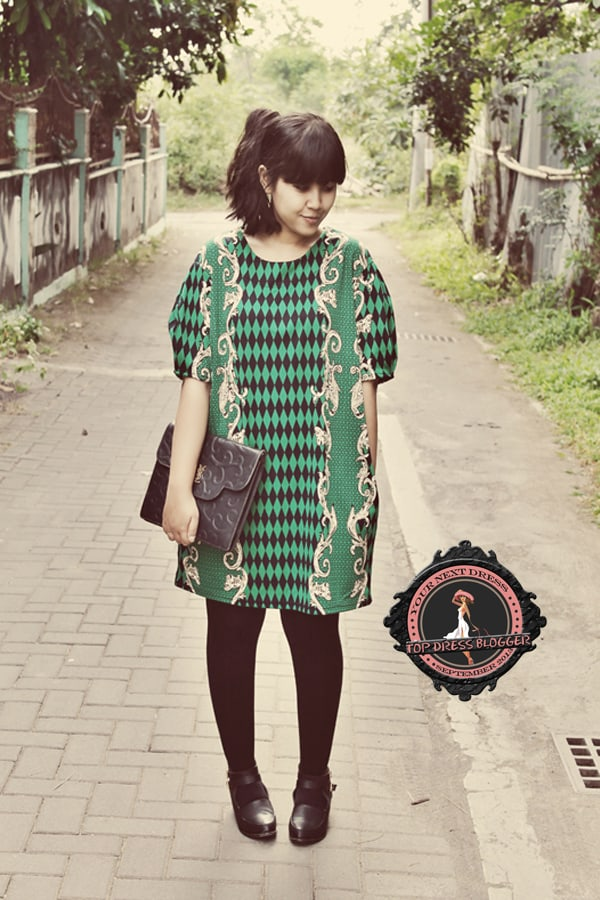 Marla in a haute-couture boxy mini dress