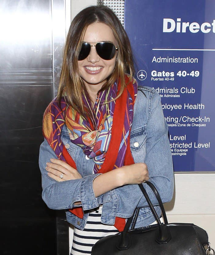 Miranda Kerr styled her maxi dress with a colorful layer of scarves