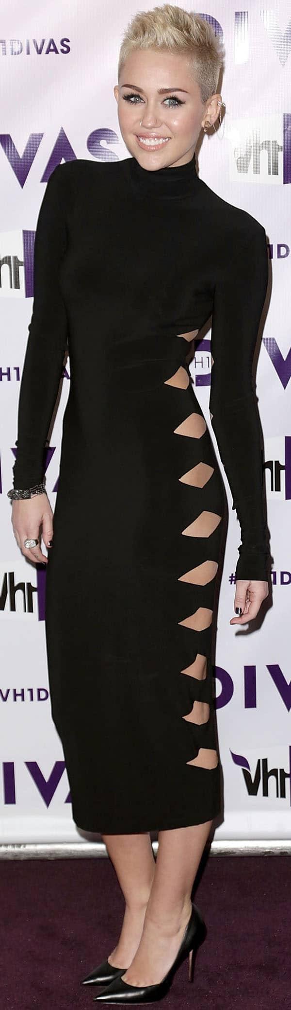 Miley Cyrus' Omo by Norma Kamali black turtleneck dress