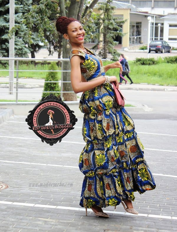 Onyinye in a unique, colorful printed tier dress