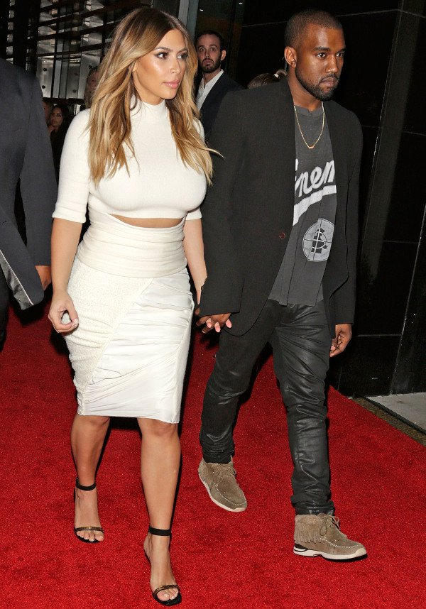 Kim Kardashian and Kanye West at Gelila & Wolfgang Puck's Dream for Future Africa Foundation honoring Vogue Italia Editor-In-Chief Franca Sozzani at Spago in Beverly Hills on October 24, 2013
