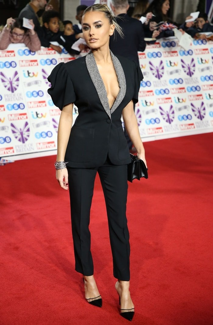 Braless Amber Davies arrives in a black John Richmond pantsuit on the red carpet of Pride of Britain 2019
