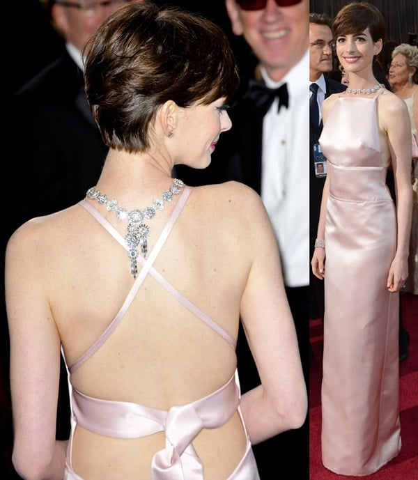 Anne Hathaway did not bother to wear a bra in a pink dress from Prada