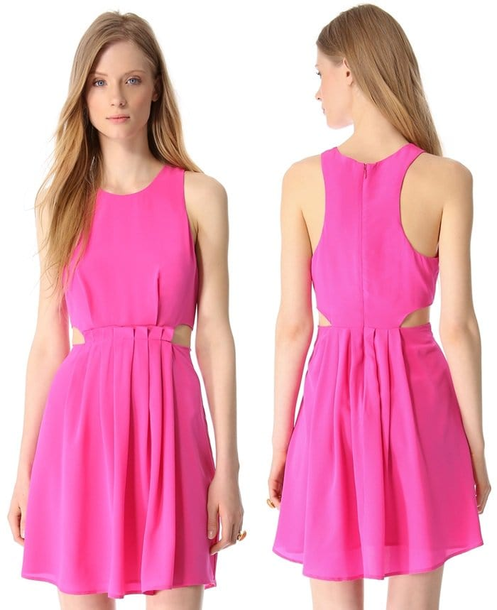 Figure-defining cutouts nip the waist of a sleeveless silk dress featuring a row of precise pleats that add movement to the skirt, and a single, wide pleat accents the bodice