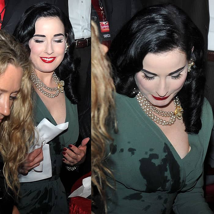 Even the always graceful and elegant Dita Von Teese couldn't avoid spilling something on herself width=