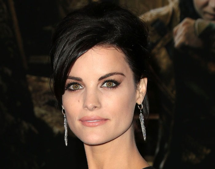 Jaimie Alexander's silver feather-shaped earrings