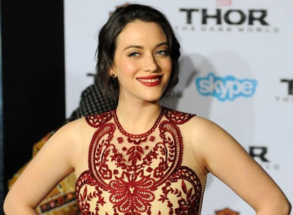 Kat Dennings' hair was styled in a loose chignon with soft tendrils that framed her gorgeous face