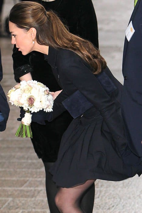 Kate managed to hold down her wind-caught skirt while still focusing on her chat with the school girl
