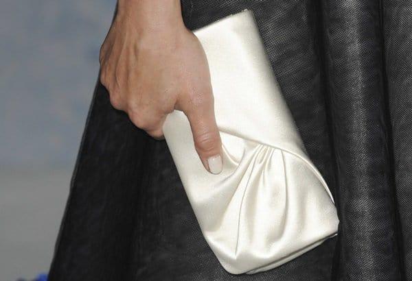 Kristen Bell's white satin Louboutin clutch