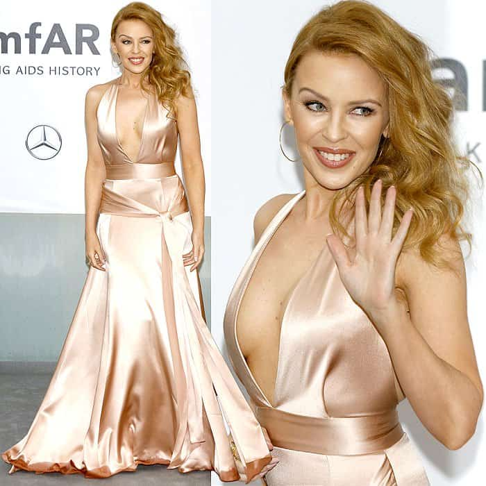 Kylie Minogue had the misfortune of wearing a Juan Carlos Obando satin dress that showed all the water it had soaked up at the hemline