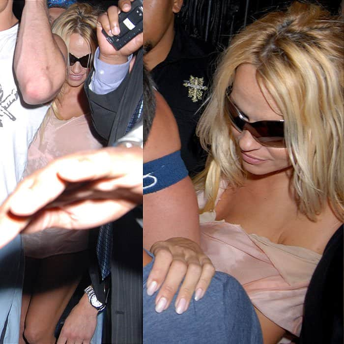 It must've been one helluva night for Pamela Anderson because she came out with her dress stained, spilled on, and ripped