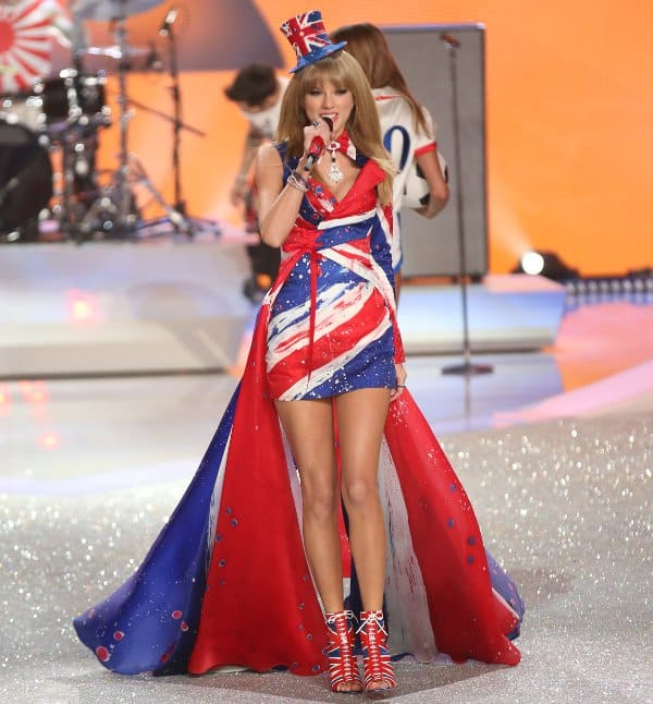 Swift's first dress — a short Union Jack–themed dress with an imposing train and a cute top hat