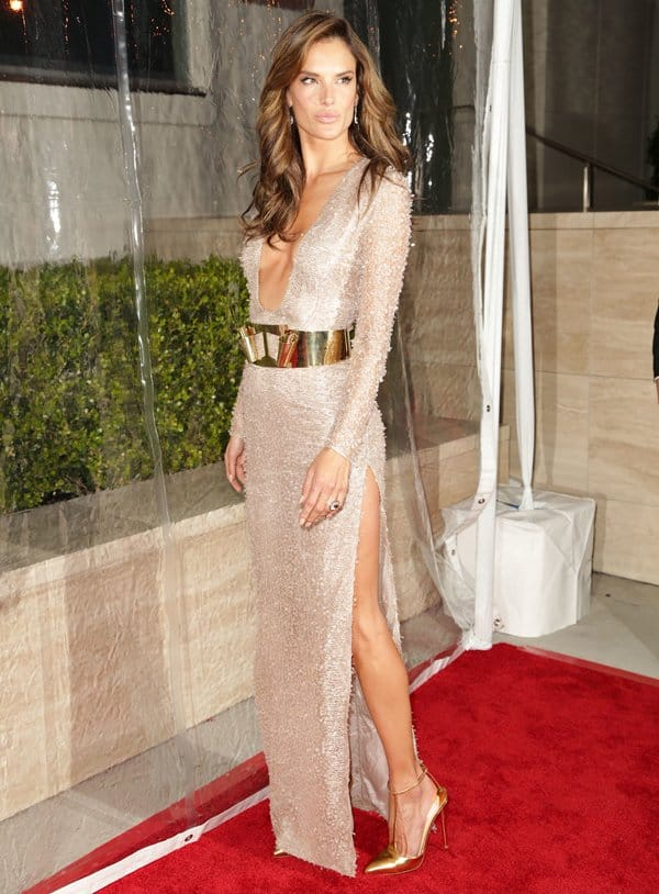 Alessandra Ambrosio in an embellished Hugo Boss dress with a gold-plated belt