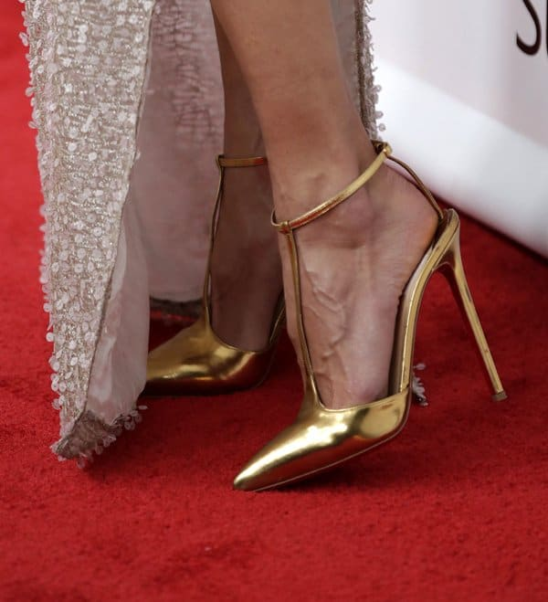 Alessandra Ambrosio put her hot feet on display in gold pumps