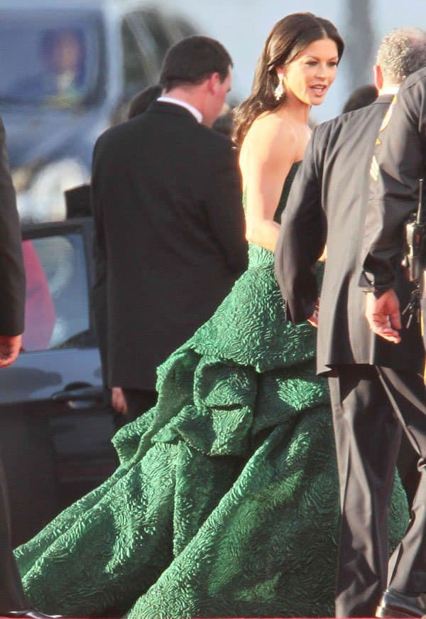 Catherine Zeta-Jones donned a hunter green strapless ball gown from Monique Lhuillier Pre-Fall 2011 Collection