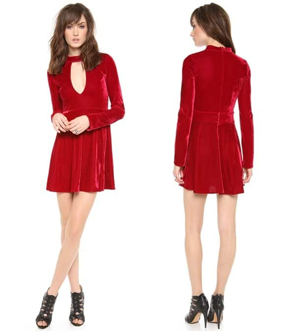 A cutout bodice under a high collar lends allure to this ruby red velvet dress