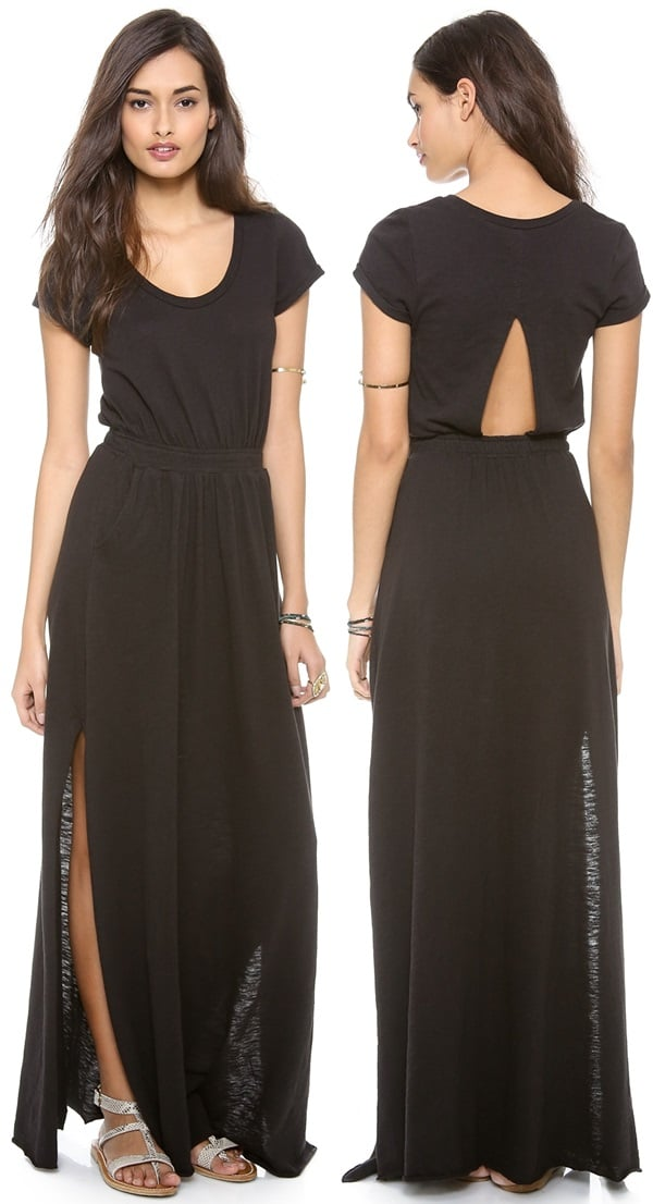 A casual knit black dress gains flattering definition from a gathered elastic waist