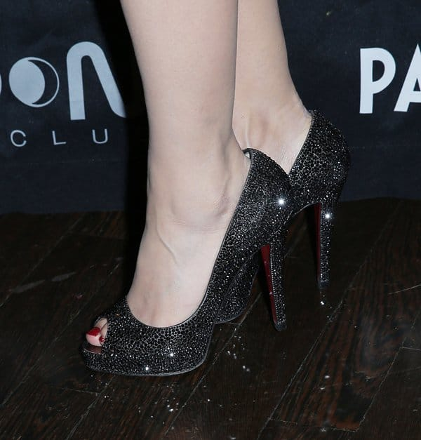 Holly Madison showed off her feet in Christian Louboutin shoes