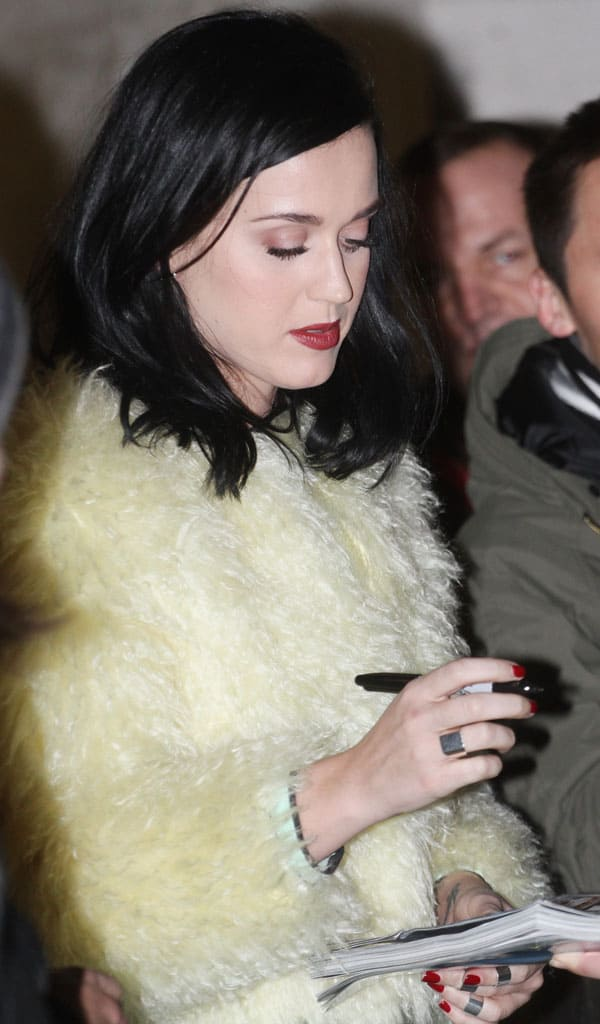Katy Perry signing autographs outside the studios of Kiss FM in London on December 10, 2013