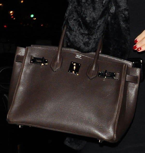 Katy Perry toting a brown Hermès Kelly bag