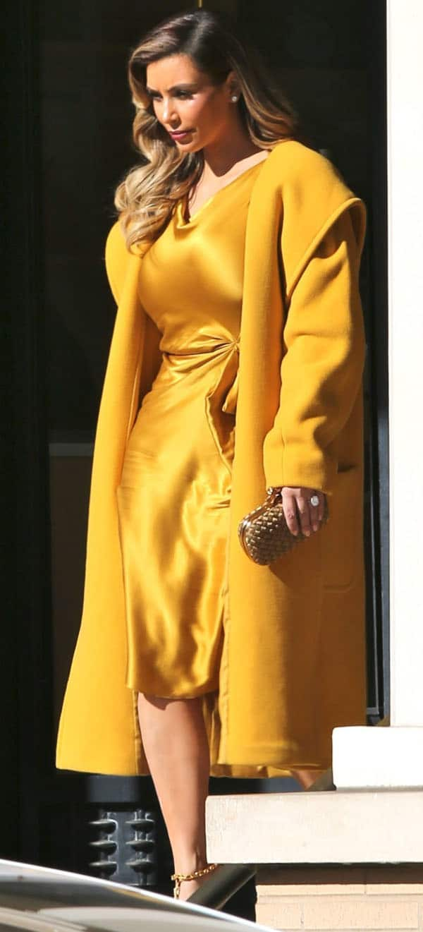 Kim Kardashian took a break from her mommy duties, looking every bit like an Oscar statue come to life in a head-to-toe gold-toned ensemble in Beverly Hills