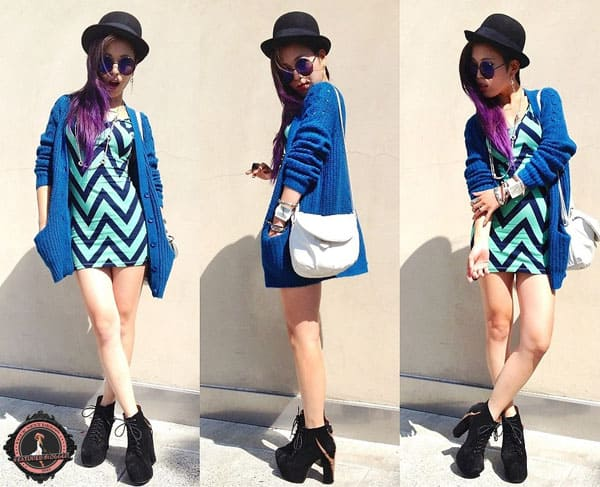 Aika flaunts her legs in an electric blue cardigan