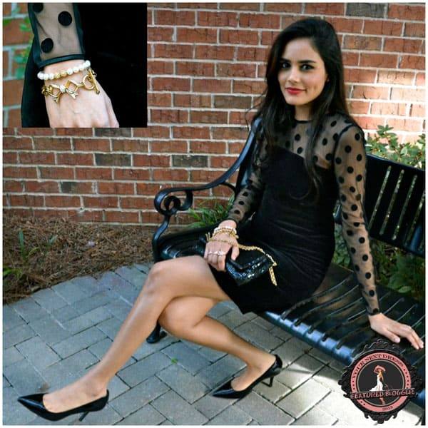 Alpa wears a black Juicy Couture velvet polka dot dress with matching Kenneth Cole pumps